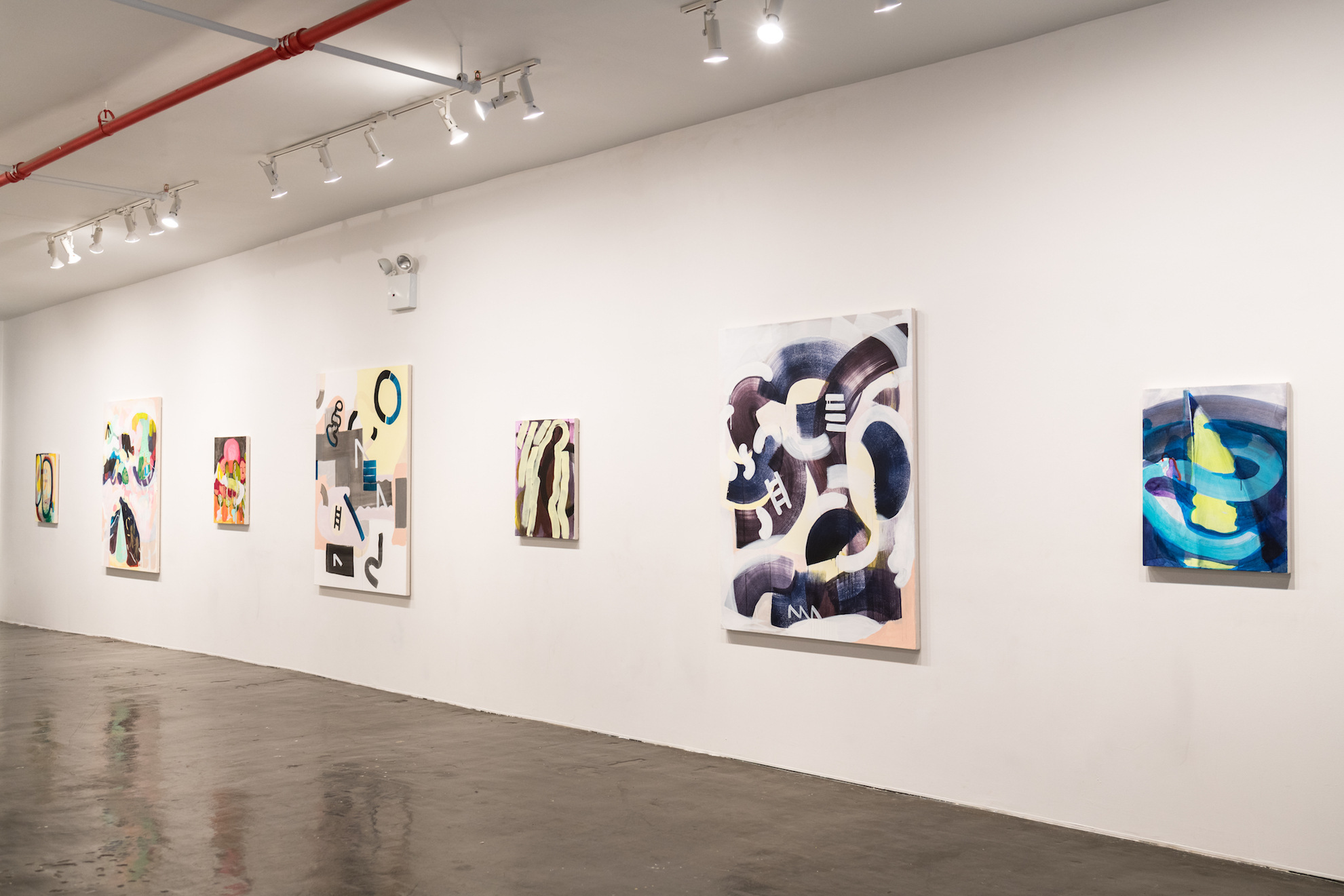 Installation views of paintings at Recess. Seven paintings are visible from the photographs, in various sizes.